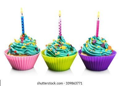 colorful fresh cupcakes with candles isolated on white background