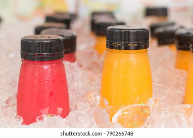 Colorful fresh juicy water and cooled with ice cubes.
