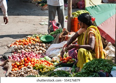 The colorful of fresh open air Gulmandi local market. Woman selling vergetables on street side walk. This is one of the largest bazaars in Aurangabad, India.