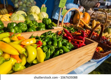 Colorful fresh organic vegetables on display at a vendors produce stand at the farmers market in Windermere, British Columbia, Canada