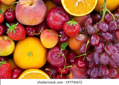 Colorful fresh summer fruits as a background