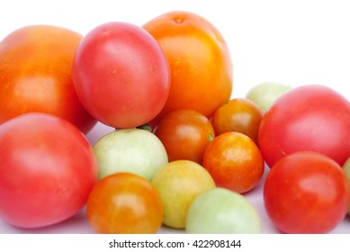 colorful of fresh tomatoes isolated on a white background with copy space for text
