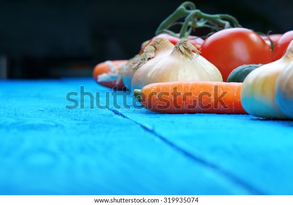 Colorful fresh vegetables on blue table
