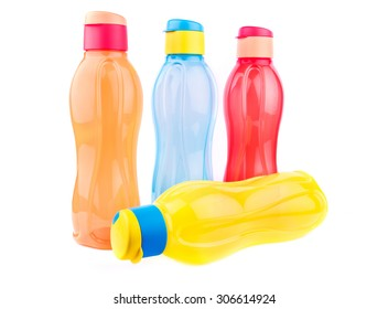 Colorful fridge pet bottles isolated over white background