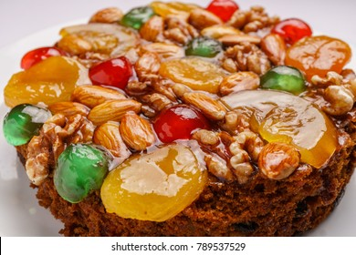 Colorful fruit cake, various fruits on top
