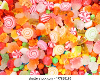 Colorful fruit candies and jellies background