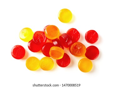 Colorful fruit hard candy isolated on white background top view