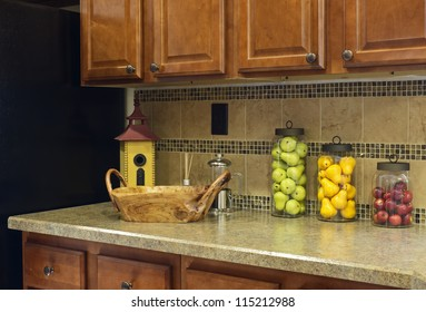 Colorful fruit jar decor on a home kitchen counter
