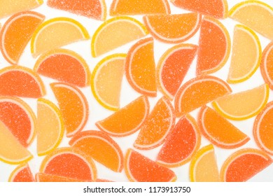 Colorful fruit marmalade. Lemon orange grapefruit. Jelly on white background