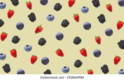 Colorful fruit pattern of berries yellow background. Top view.