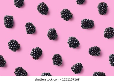 Colorful fruit pattern of blackberries on pink background. Top view. Flat lay