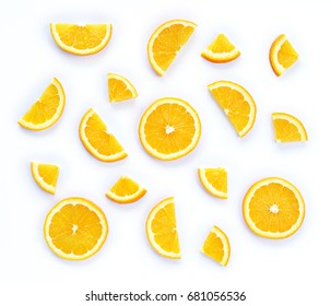 Colorful fruit pattern of fresh orange slices on white background. From top view