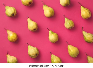 Colorful fruit pattern of fresh pears on pink background. From top view