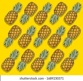 Colorful fruit pattern of fresh pineapples on yellow background. Tropical abstract fruit pattern. Minimal summer food concept. Flat lay, top view