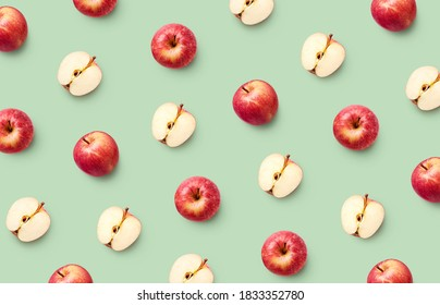 Colorful fruit pattern of fresh red apples on light green background - Shutterstock ID 1833352780