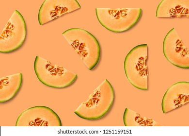 Colorful fruit pattern of melon slices on orange background. Top view. Flat lay