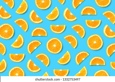 Colorful fruit pattern of orange slices on blue background. Top view. Flat lay
