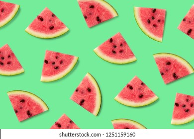 Colorful fruit pattern of watermelon slices on green background. Top view. Flat lay