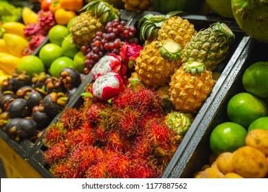 colorful Fruit stall lemon,pineapple,mango rambutan