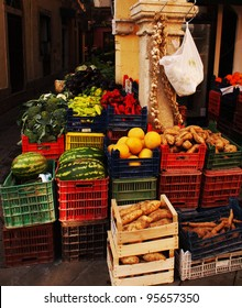 Colorful fruit and vegetables in crates on the street corner in Corfu, Greece.