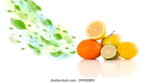 Colorful fruits with green organic leafs on white background