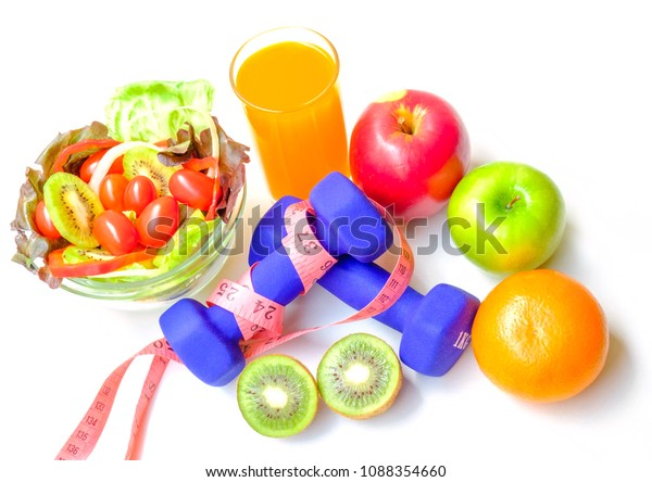 colorful fruits and vegetables on white background with measuring tape wape around Blue dumbbell  ,health care concept