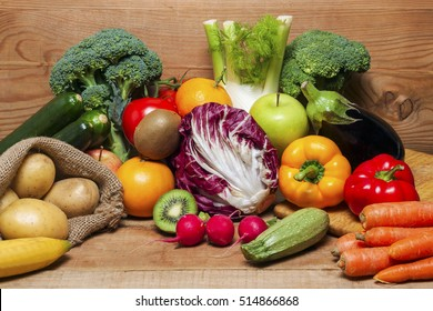 Colorful fruits and vegetables on wood background