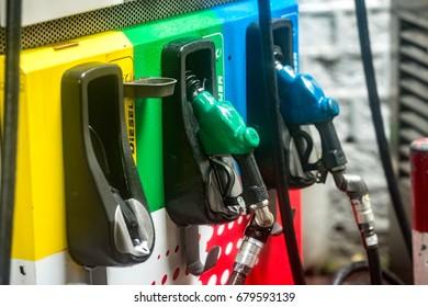 Colorful fuel oil gasoline dispenser at petrol filling station.