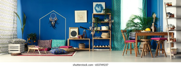 Colorful fully furnished room decorated in boho style