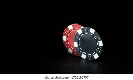 Colorful gambling chips isolated on the black background. Chips of different colors isolated on a black background