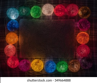 Colorful garland with space for text on the caged background