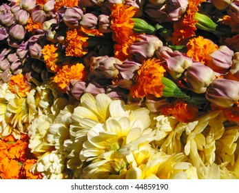 colorful garlands of flowers in a heap
