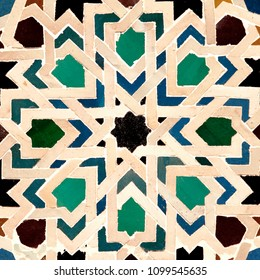 The colorful geometric patterns of an Islamic mosaic decorate the Alhambra Palace in Granada, Spain.