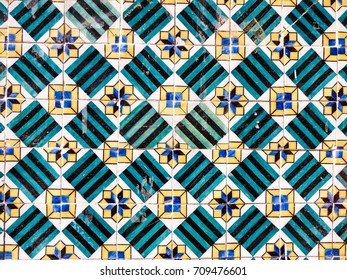 Colorful geometric Portuguese tiles (azulejos) pattern with mismatched tiles in Lisbon