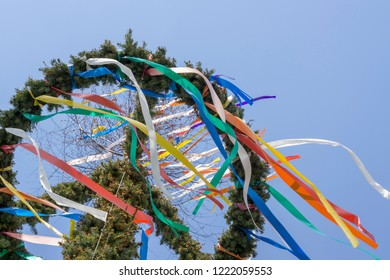 Colorful german maypole in front of blue sky