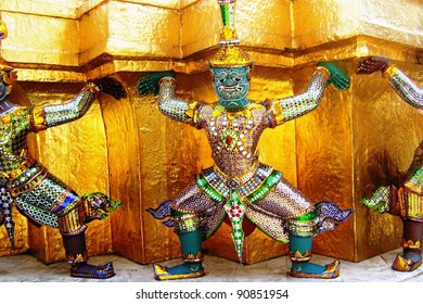 Colorful giants on a building in the complex of the royal palace in Bangkok in Thailand