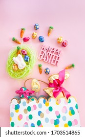 Colorful gift bag with cheerful easter treats and chocolates