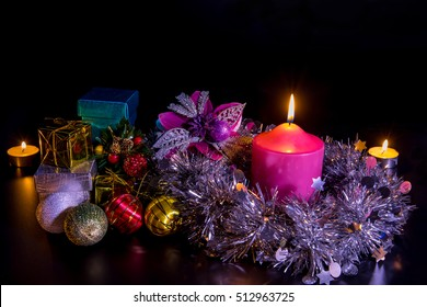 Colorful gift box and decor of christmas with candle.