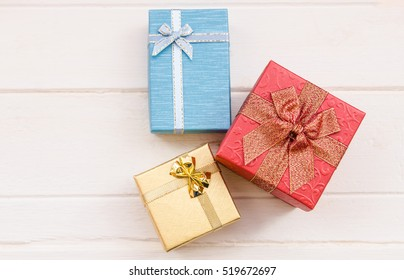 Colorful gift box on wooden background for Christmas and New Year 2017.