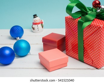 Colorful gift box warp white ribbon and decoration object and cute vintage on pastel color background for Christmas and The New Year .