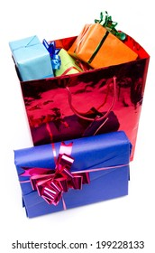 Colorful gift boxes in a bag, isolated on white