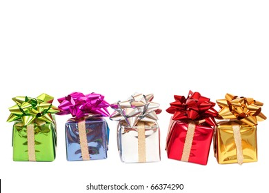Colorful gift boxes with a bows for Christmas or Valentines Day isolated on white background with copy space