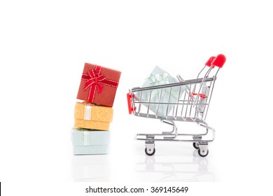 colorful gifts box,supermarket shopping cart on white background