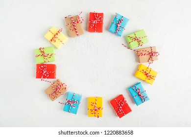 Colorful gifts with Cristmas rope over white background, flat lay style with copy space