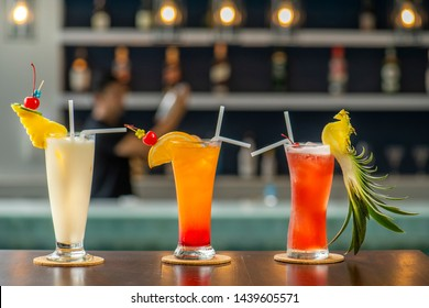 colorful gin tonic cocktails in glasses on bar counter in pup or restaurant .Some bar have non alcoholic drinks or mocktail it make from tropical blended fruit margaritas, passionfruit drinks.