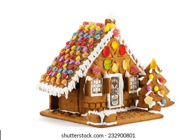 Colorful gingerbread house isolated against white background
