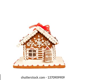 Colorful gingerbread house isolated on white background