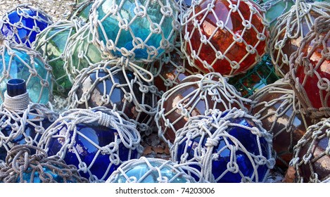 Colorful glass fishing floats with netting. Glass floats provided buoyancy, but were sometimes lost and washed ashore.