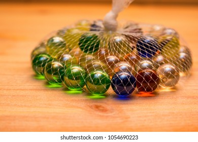 Colorful glass marbles in net