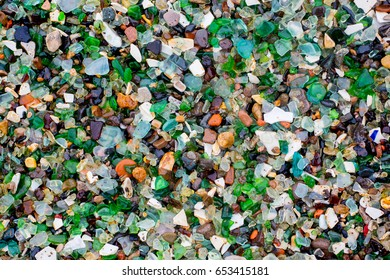 Colorful glass stones on a sea beach in close up background
